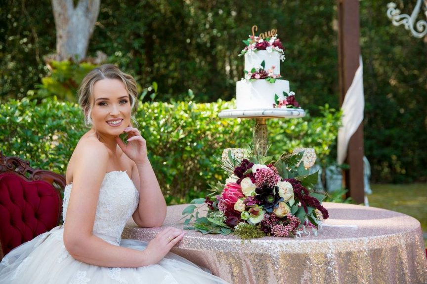bride with wedding cake and flowers